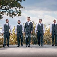 Groom & groomsmen walking the road